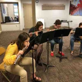 Sitka Fine Arts Camp high school flute class working on embouchures in the mirror
