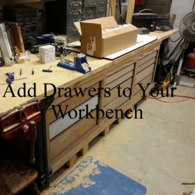 Original workbench with middle shelf removed and cabinets added.