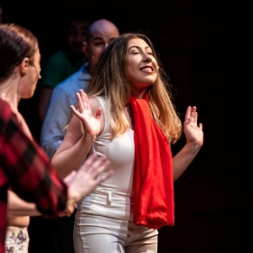 Olivia acting in Wavestage Theatre Company's production of the Musical, Godspell.