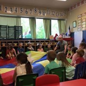 Working on team work and social skills with parachute music activity. So much fun!!!!