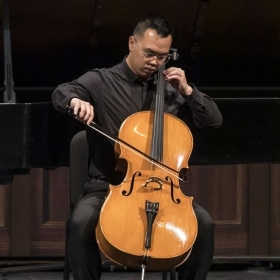 Performing a Bach Cello Suite at the Granada Theater in Santa Barbara, CA.