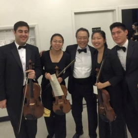 backstage after performing a concert with Yo-Yo Ma