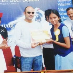 Getting award from famous Indian cricketer, Virendar Sehwag.