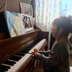 She is really enjoying her piano lessons!