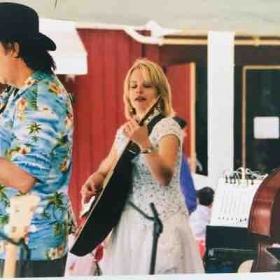 Performing with a blue grass band.