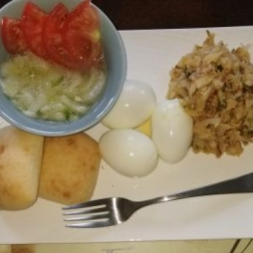 Cucumber salad, cod fish, hard boil eggs and bakes (dinner rolls)