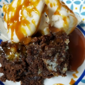 Cheesecake Brownie ala mode w/warm caramel sauce