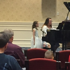 Accompanying a vocal student for a recital