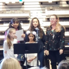 Singing a group song with a few of my voice students at an open mic event