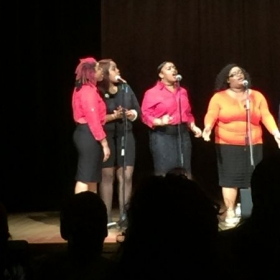This picture was taken at my gospel concert I am with the pink locs to the far left of the picture