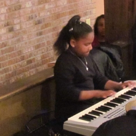 Student displaying her talent at a public  event.
