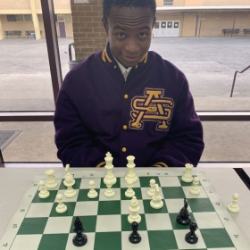 Playing one of my former students in chess. (Tyler currently attends Notre Dame University).