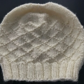 Knit: My hat project for third level beginner knitters.