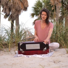 Singing and playing harmonium! Harmonium is a small floor organ, invented in France and prolifically used in India
