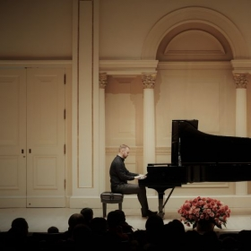 Performing at Carnegie Hall, New York City.