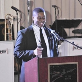 Na'Zir speaking at the Fresh Smiles Gala after receiving two career grants.