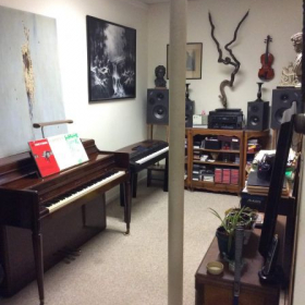 Room where lesson will be conducted. There is an area to the right of the violin where a parent may sit during the lessons.