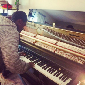 Student explores the inner workings of our acoustic piano