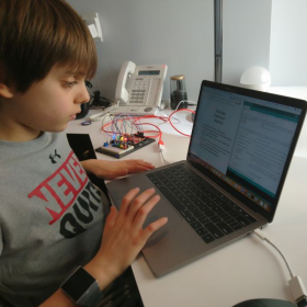 My student writing a programming the mimics police car siren.