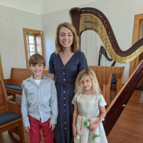 A proud brother-sister, following their solo harp performances