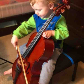 Stephen (2 years old) playing on his 1/16 cello!