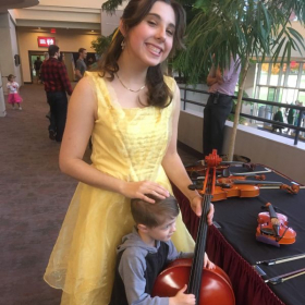 One of my students and I at a Halloween event where children got to come and play various instruments.