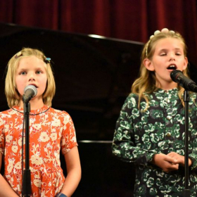 Paloma's students perform their songs at the Winter Vocal Recital