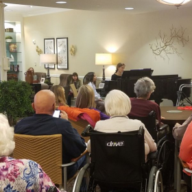 Natale  playing at a local senior living home.