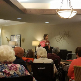 Reading my book at a local senior living home.