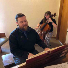 Playing for church service with my older brother on the piano.