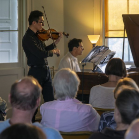 Performing a violin recital at the Laurel Hill Mansion's Concerts by Candlelight.