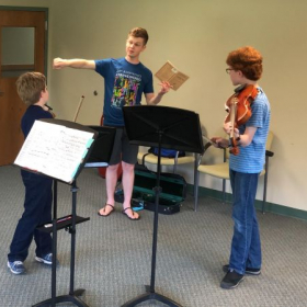Lucas works with chamber music students at Stringwood Music Festival Lanesboro, MN photo by Vicki Blazing