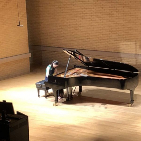 This picture was taken during my First recital at my University, also the first actual full program recital of just piano!
