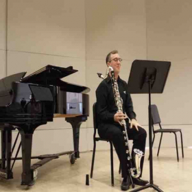 Here is a picture of me getting ready to shred on some bass clarinet during my Senior Recital.