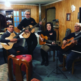 Learning all about the Cueca Chilote and other Chilean folk rhythms from these incredible musicians in Puerto Montt Chile.