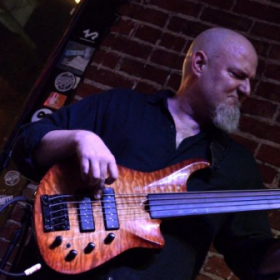 Rocking the Roscoe 5-string fretless; tunes D-A-D-G-C