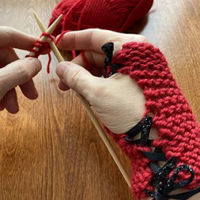 If you're a beginning knitting student, you can learn to make these cute fingerless mitts in your very first lesson!