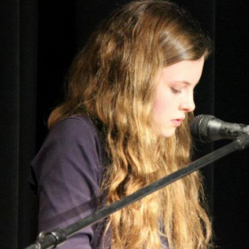 "Performing at my high school's show, ""Public Domain."""