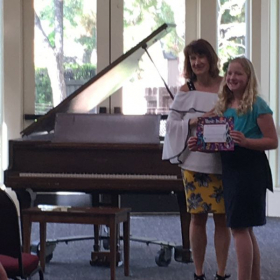 """Isabelle receivers her """"Certificate of Achievement"""" after our Spring Recital in 2019."""