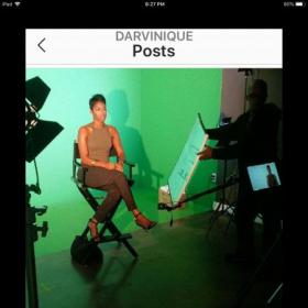 Darvinique doing an interview on the Independent film set A Full Loaf.