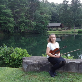 With my violin in front of Lake Milner on the Brevard Music Center campus in Brevard, NC in summer 2019.