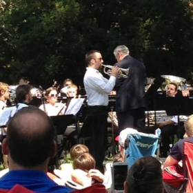 Performing a cornet solo with the UGA Wind Ensemble at an outdoor concert in Athens, GA.