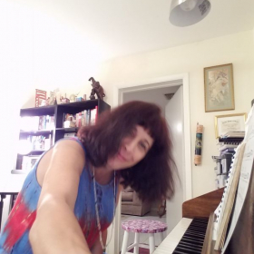 Hello.this is my home, and here I am getting ready to record myself playing the piano!!