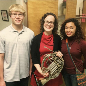 Meeting with two of my students from Milford High School after performing in a Christmas horn choir performance