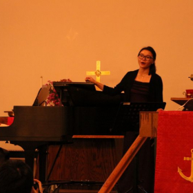 Miss Molly performing singing in her studio recital