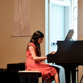 Miss Molly's student performing in the studio recital