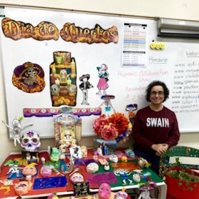 "Putting up an altar for the ""Day of the Dead"" in my classroom. Students made most of the decorations."