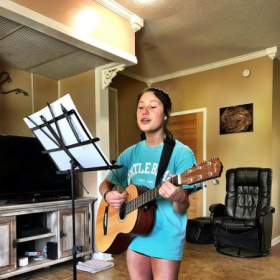 Ashley - Singer,Song-writer, Actress, Musician working on a new song she wrote.