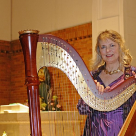 I played this concert on a Lyon & Healy 85 P, a 40-string pedal harp, easier to haul in snowy seasons.  Gut-strung, lovely warm tone.