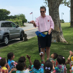 Mr. Jeffo performs some fun summertime magic for camp kids.